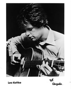 black and white photo of Leo Kottke playing an acoustic guitar with a microphone close to his hands