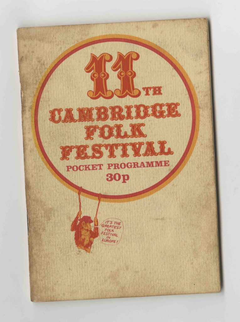 11th Cambridge Fold Festival Pocket Programme cover with an orange and red colored monkey swinging on circle ring